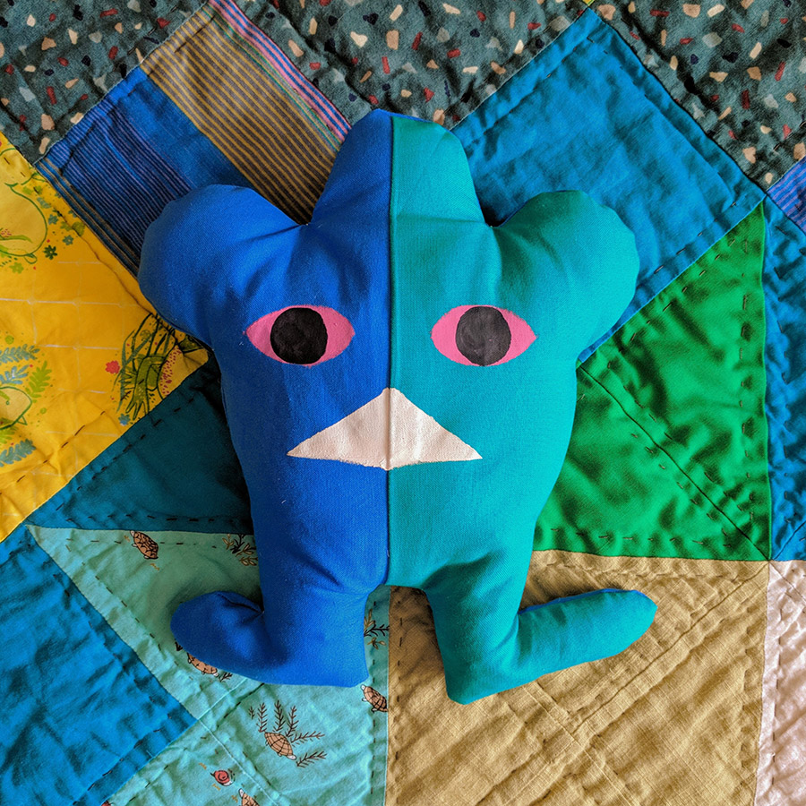 **009** This is Null. He's quite scary looking, but he just likes blending in with quilts.