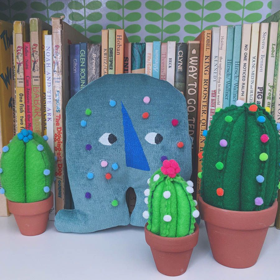 **023** This is Ote. He hides behind your faux cactus collection.